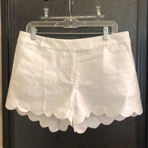White linen shorts with scalloped hem